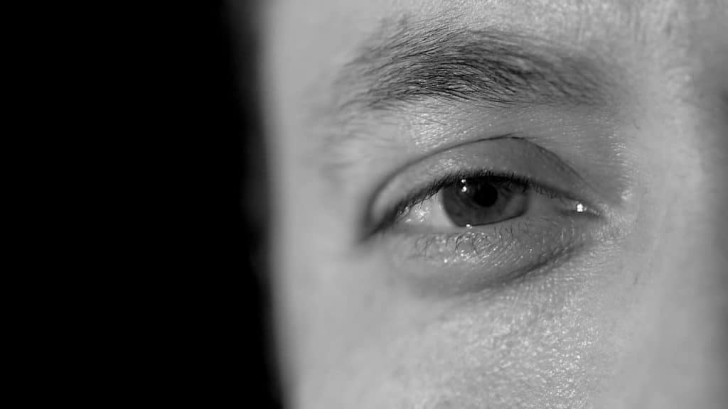 a close up of an eye, the image is black and white