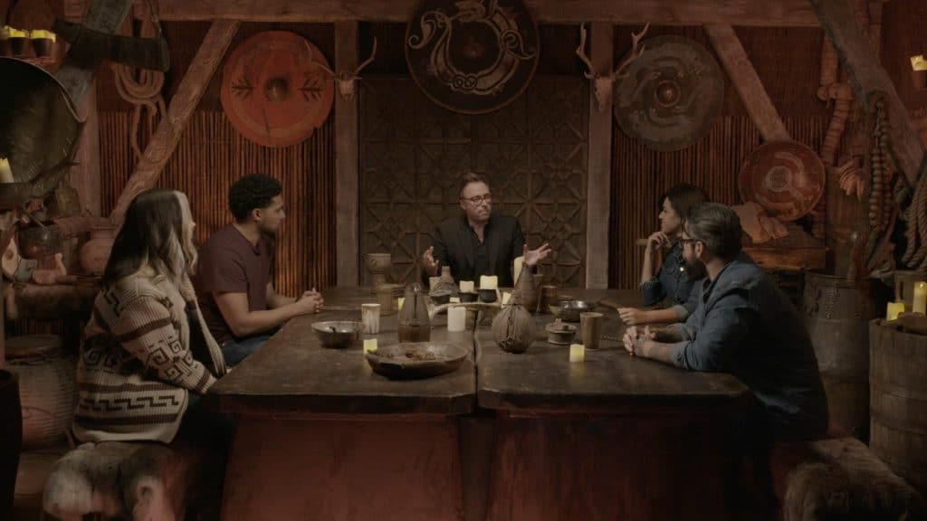 some actors sitting round a viking-era table and set