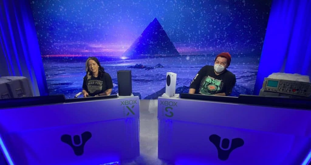 two people sitting at desks on a wintery set